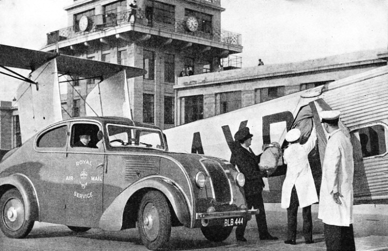 LOADING MAILS ON BOARD AN IMPERIAL AIRWAYS LINER at Croydon Airport