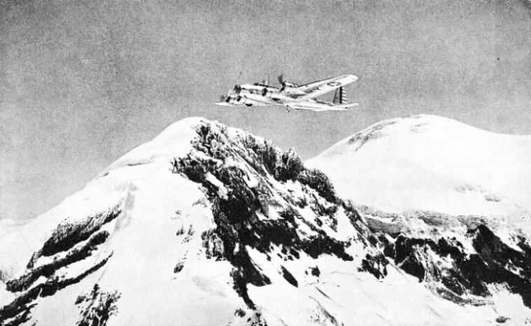 A UNITED STATES ARMY AIR CORPS MACHINE in flight above Mount Rainier