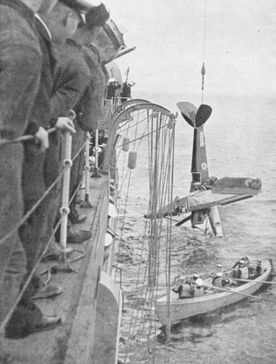 HOISTING A DAMAGED QUEEN BEE ON BOARD A WARSHIP