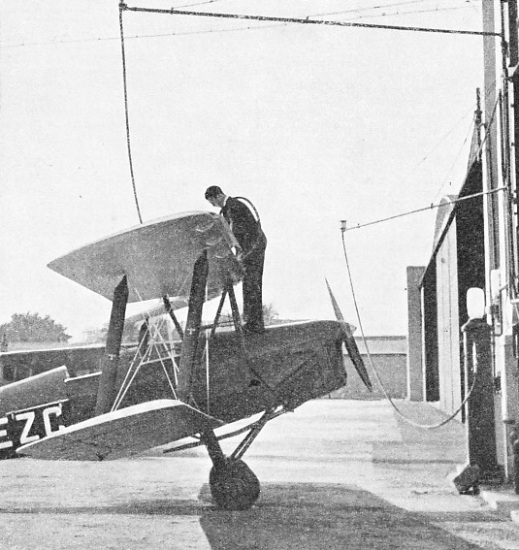 FILLING UP WITH PETROL outside a hangar at Brooklands Aerodrome, Surrey
