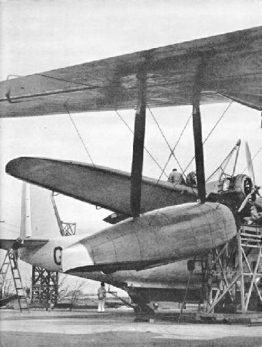 THREE PAIRS OF WHEELS are attached to the hull of a flying boat to enable the aircraft to be pulled out of the water and up the slipway