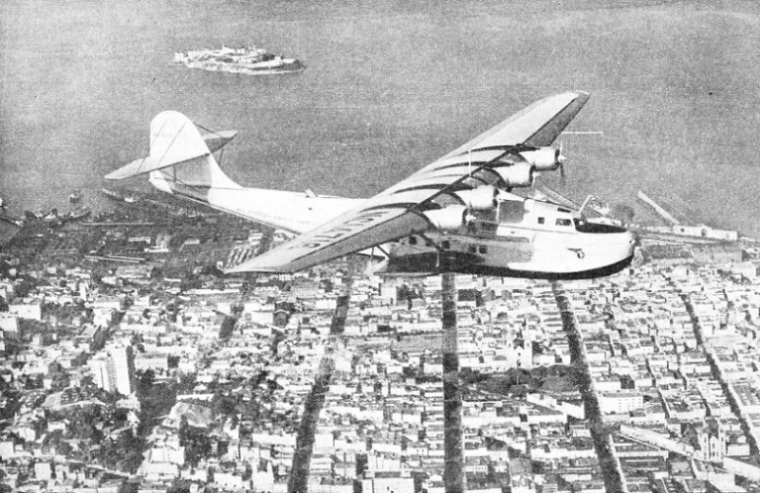THE CHINA CLIPPER FLYING OVER SAN FRANCISCO, California, at the start of a flight to Manila