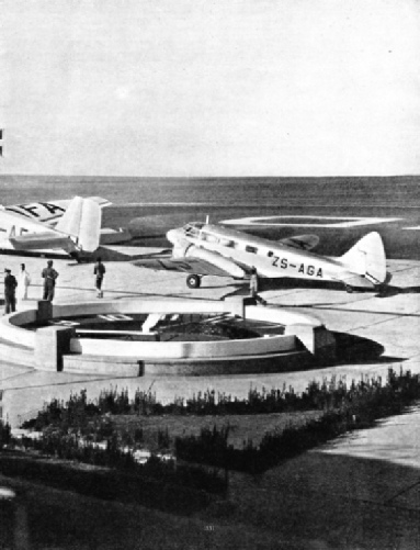 AIRCRAFT IN FRONT OF THE BUILDINGS AT THE RAND AIRPORT