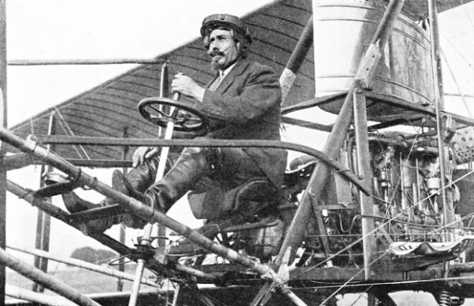 Samuel Franklin Cody, seated in one of his biplanes