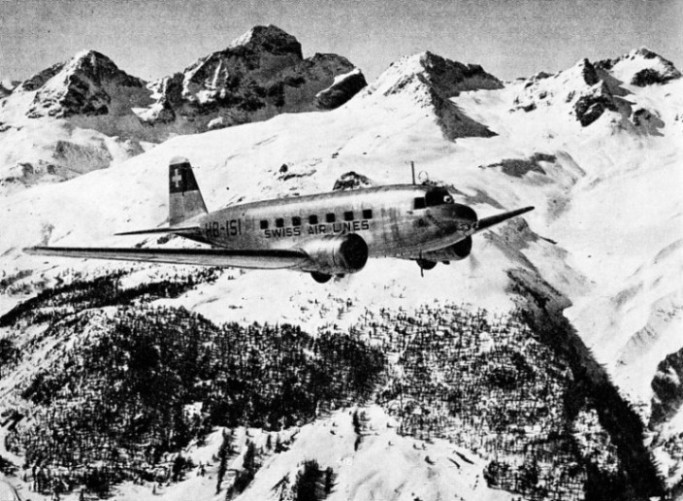 A SWISSAIR MACHINE FLYING NEAR ST. MORITZ AERODROME