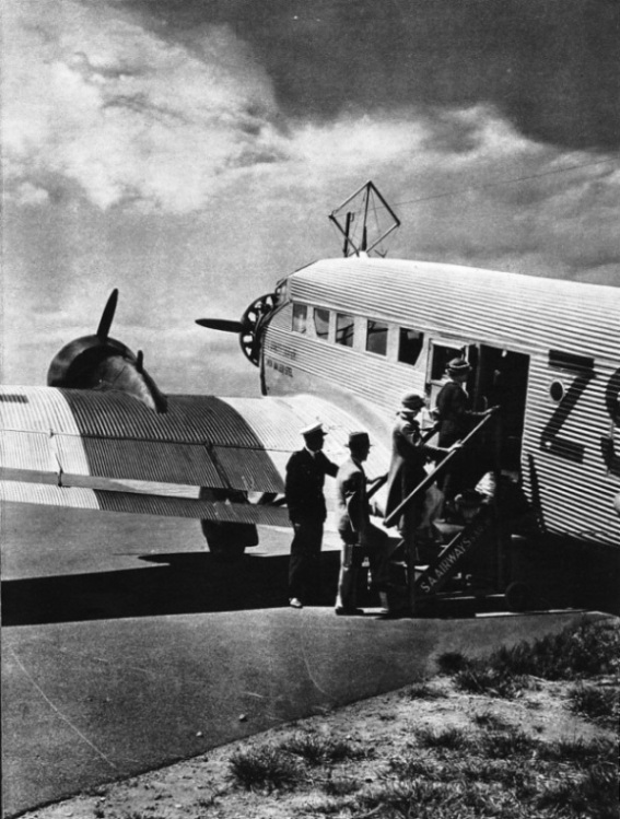 PASSENGERS BOARDING ONE OF THE JUNKERS AIR LINERS of South African Airways